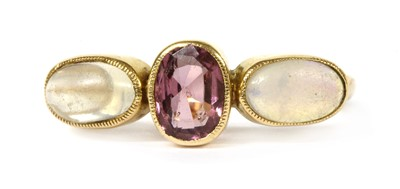 Lot 20-An Edwardian gold garnet, opal and moonstone ring