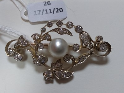 Lot 26 - A late Victorian pearl and diamond scrolling brooch