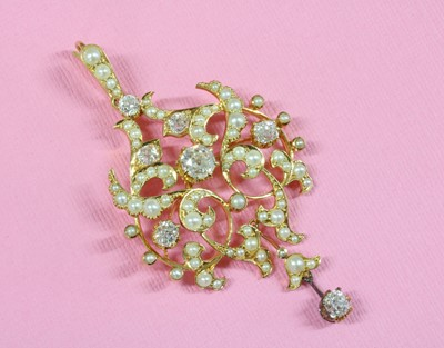 Lot 96 - A late Victorian diamond and split pearl cartouche shaped brooch/pendant, c.1890