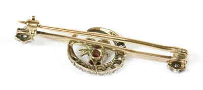 Lot 13-A gold and silver, diamond, ruby and sapphire crescent bar brooch