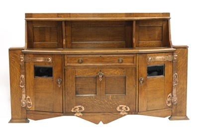 Lot 14 - An Arts and Crafts oak cabinet