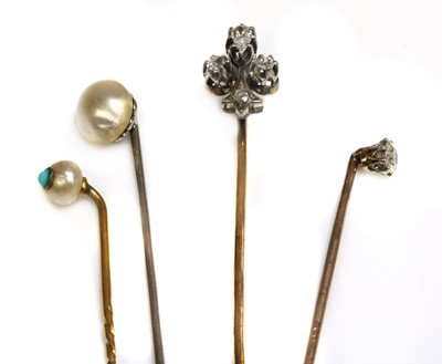 Lot 51 - A cased diamond set fleur-de-lys stick pin, early 20th century