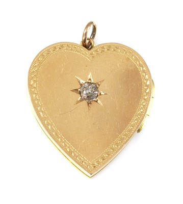 Lot 87 - An 18ct gold diamond set heart-shaped hinged locket