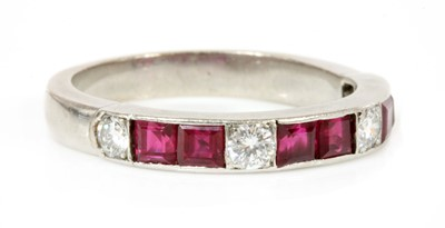 Lot 181 - A ruby and diamond half eternity ring