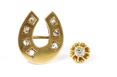 Lot 22-A gold diamond horseshoe brooch