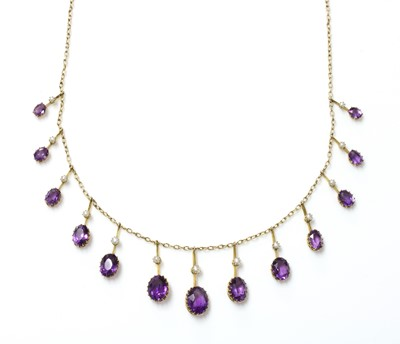 Lot 77 - An Edwardian amethyst and split pearl fringe necklace