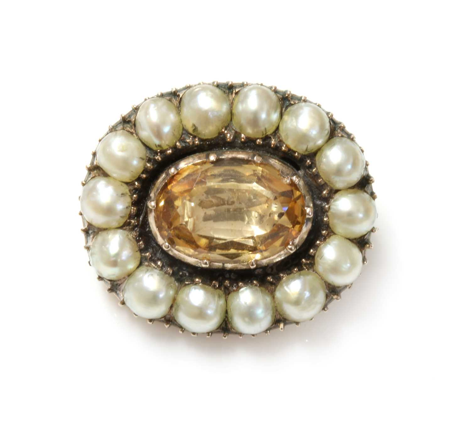 Lot 11-A Georgian foiled topaz and split pearl brooch
