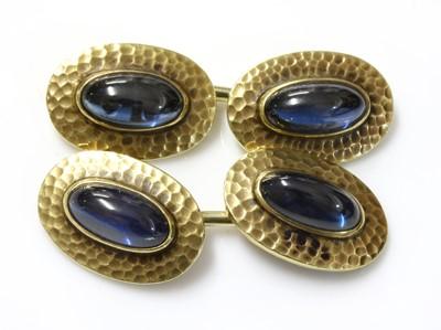 Lot 172 - A pair of gold sapphire set cufflinks