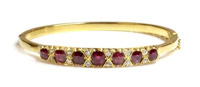 Lot 39 - A ruby and diamond hinged bangle