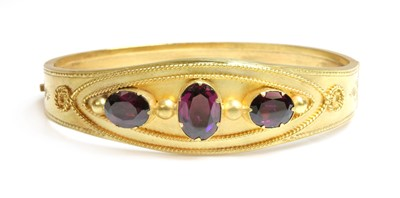 Lot 30 - A Victorian garnet set gold bangle, c.1870