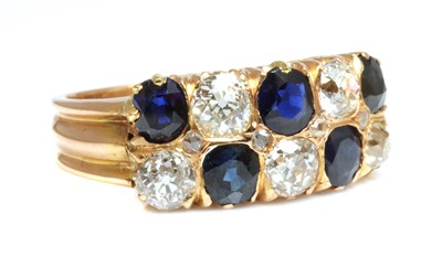Lot 48 - A rose gold two row sapphire and diamond ring, c.1910