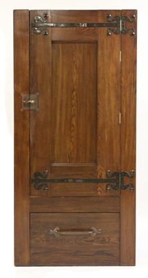 Lot 12-An Arts and Crafts oak wardrobe