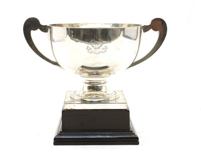 Lot 17-A George V silver twin handled trophy with scroll handles and square plinth base