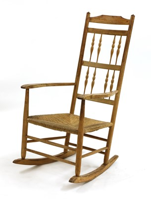Lot 37 - An ash spindle back rocking chair
