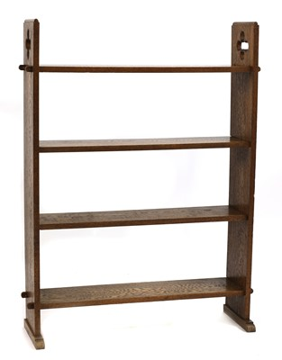 Lot 17-An Arts and Crafts four-tier open bookshelf