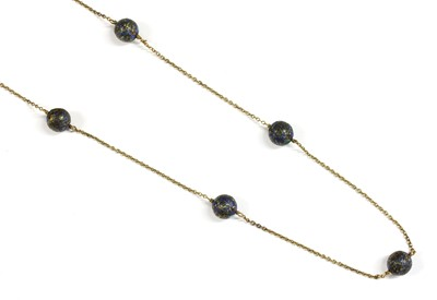 Lot 42 - A gold enamel bead necklace