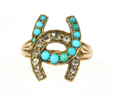 Lot 5-A gold diamond and turquoise horseshoe ring