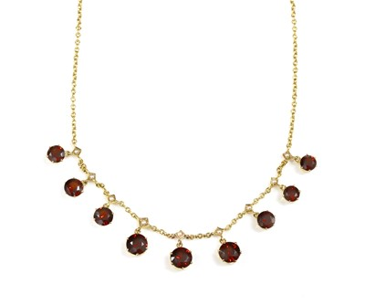 Lot 92 - A 9ct gold garnet and split cultured pearl fringe necklace