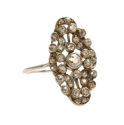 Lot 147 - A Continental diamond set navette-shaped plaque ring