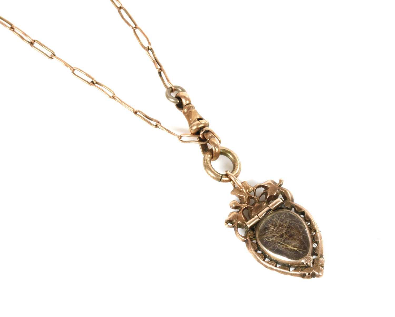 Lot 17-A Georgian heart-shaped split pearl glazed locket