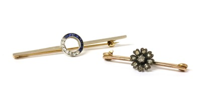 Lot 28 - A diamond and sapphire bar brooch