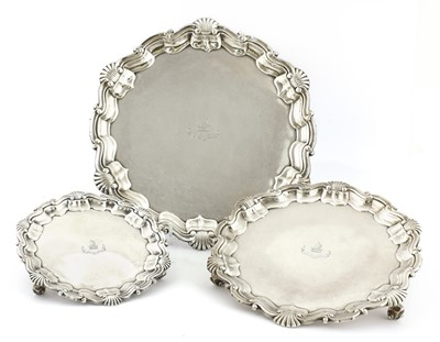 Lot 25 - A set of three graduated silver salvers