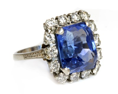 Lot 105 - An American sapphire and diamond cushion-shaped cluster ring