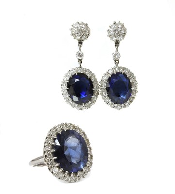 Lot 190 - An American synthetic sapphire and diamond oval cluster ring and earring suite