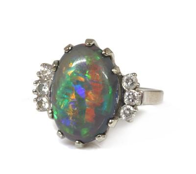 Lot 104 - An American black opal and diamond ring