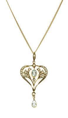 Lot 34 - An Edwardian gold aquamarine and split pearl pendant