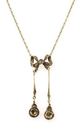 Lot 35 - A gold diamond négligée pendant