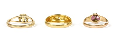 Lot 12-An 18ct gold five stone diamond and split pearl ring