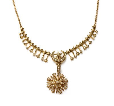 Lot 83 - A late Victorian gold, split pearl, fringe and star pendant necklace, c.1900