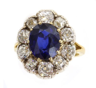 Lot 47 - A Madagascan sapphire and diamond cluster ring