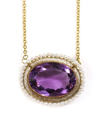 Lot 76 - A late Victorian amethyst and seed pearl oval cluster later mounted as a pendant
