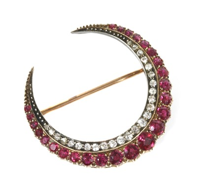 Lot 43 - A late Victorian ruby and diamond closed crescent brooch
