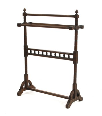 Lot 7-An Arts and Crafts walnut towel rail