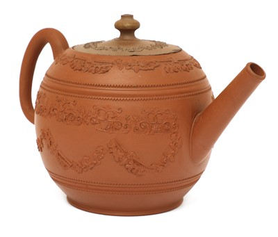 Lot 47 - A Staffordshire redware globular teapot and cover