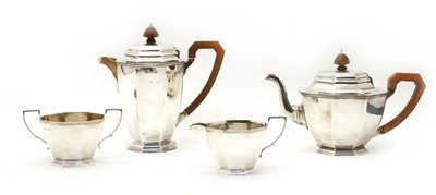 Lot 18-A George VI silver four piece tea set, of octagonal design by Adie Bros Ltd