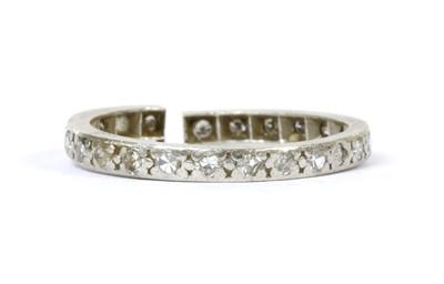 Lot 61 - A platinum diamond eternity ring