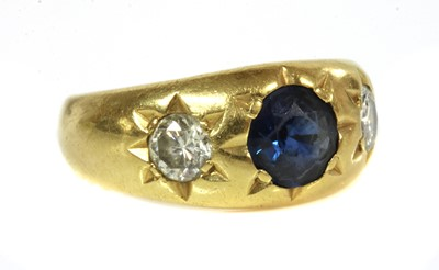 Lot 49 - A three stone sapphire and diamond gypsy ring