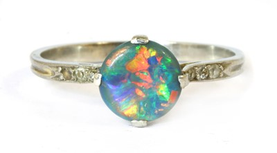 Lot 18 - A black opal and diamond ring