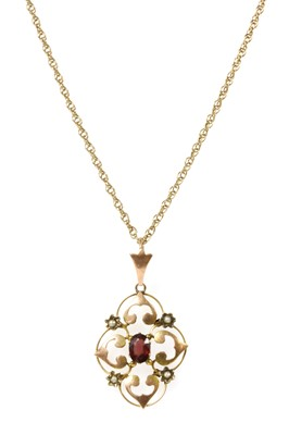 Lot 33 - An Edwardian gold garnet and split pearl pendant