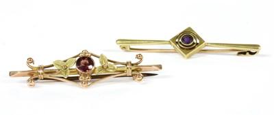 Lot 24-An Edwardian gold amethyst bar brooch