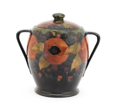 Lot 64 - A William Moorcroft 'Pomegranate' biscuit barrel and cover