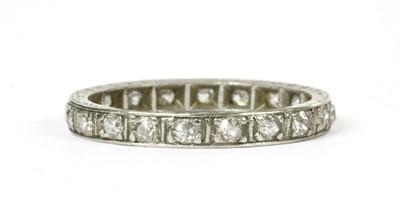 Lot 62 - A diamond full eternity ring