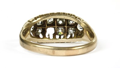 Lot 11-A gold boat shaped diamond ring