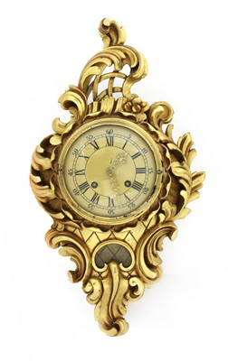 Lot 53 - A Swedish giltwood cased wall clock in the rococo manner