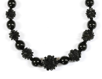 Lot 67 - A single row graduated carved jet bead necklace