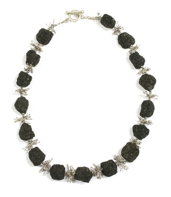 Lot 78 - A contemporary silver lava stone and cultured freshwater pearl necklace